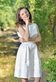 Beauty girl in a fashioned dress in a forest — Stock Photo