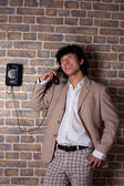 Aian man talk from old phone — Foto Stock