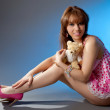 Young girl in pink dress with a toy bear — Stock Photo #8724522