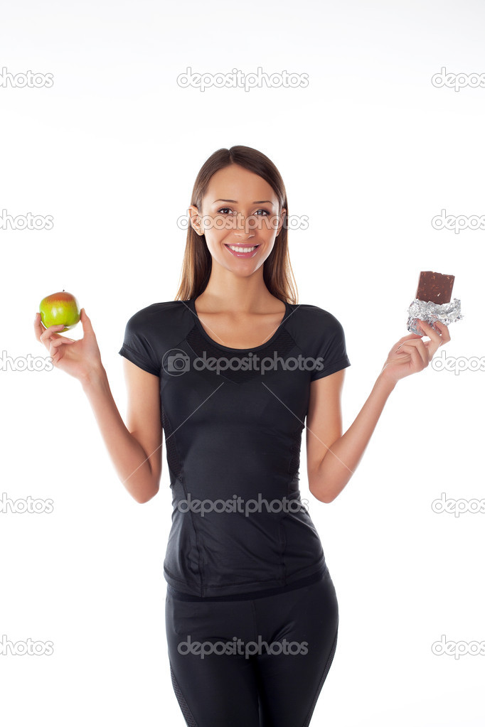 Young girl with chocolate and apple in the hands on a white — Stock Photo #8796033