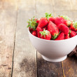 Strawberries on brown wooden table — Stock Photo