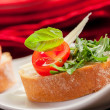 Bruschetta with Arugula and Tomatoes — Stock Photo