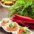Bruschetta with Arugula and Tomatoes - Stock Photo