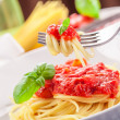 Spaghetti with Tomato Sauce on classical home table — Stock Photo