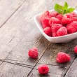Stock Photo: Raspberries on wooden table