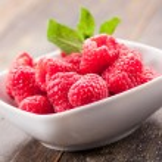 Raspberries on wooden table — Stock Photo #10545606