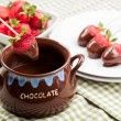 Strawberries with melted Chocolate - Stock Photo