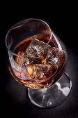 Whiskey Cognac on black background — Stock Photo