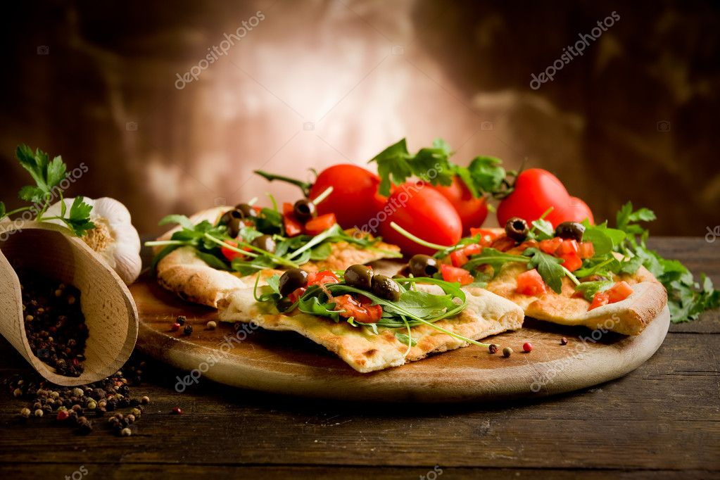 Photo of delicious vegetarian pizza with arugula on wooden table  Stock Photo #8067583
