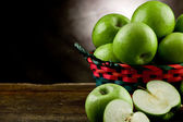 Green Apples inside a basket — Stock Photo