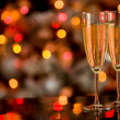 Stock Photo: Champagner on Glass Table with Bokeh background
