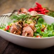 Meat Skewers on wooden table — Stockfoto