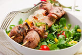 Meat Skewers on white table — Stock Photo
