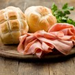 Mortadella with Bread on Chopping board — Stock Photo