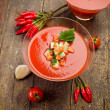 Gazpacho on wooden table - Stock Photo