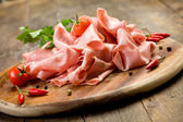 Mortadella slices with red pepper — Stock Photo