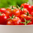 Tomatoes inside white bowl - Stock Photo