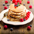 Pancakes on wooden table — Stock Photo #8765046