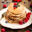 Pancakes on wooden table — Stock Photo #8765136