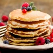 Pancakes on wooden table — Stock Photo #8765187