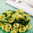 Orecchiette with Turnip tops - Stock Photo