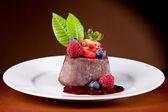 Chocolate Panna cotta with berries — Stock Photo