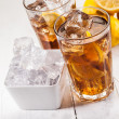 Lemon Ice Tea on white wooden table - 