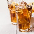 Lemon Ice Tea on white wooden table - Stock Photo