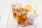 Lemon Ice Tea on white wooden table — Stock Photo