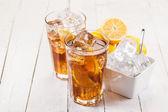 Lemon Ice Tea on white wooden table — Stock Photo