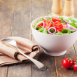 Arugula Salad with tomatoes and onion rings — Stock Photo #9930513