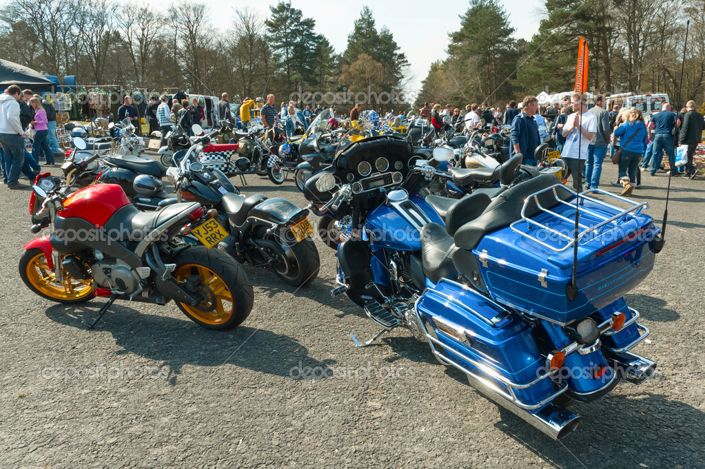 Farnborough, UK - April 6, 2012: Collection of classic and modern motorcycles on display at the Wheels Day auto and bike festival.  Stock Photo #10501278