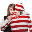 Girl hugging a young man in the hood — Stock Photo #10237010