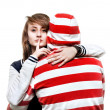 Girl hugging a young man in the hood — Stock Photo