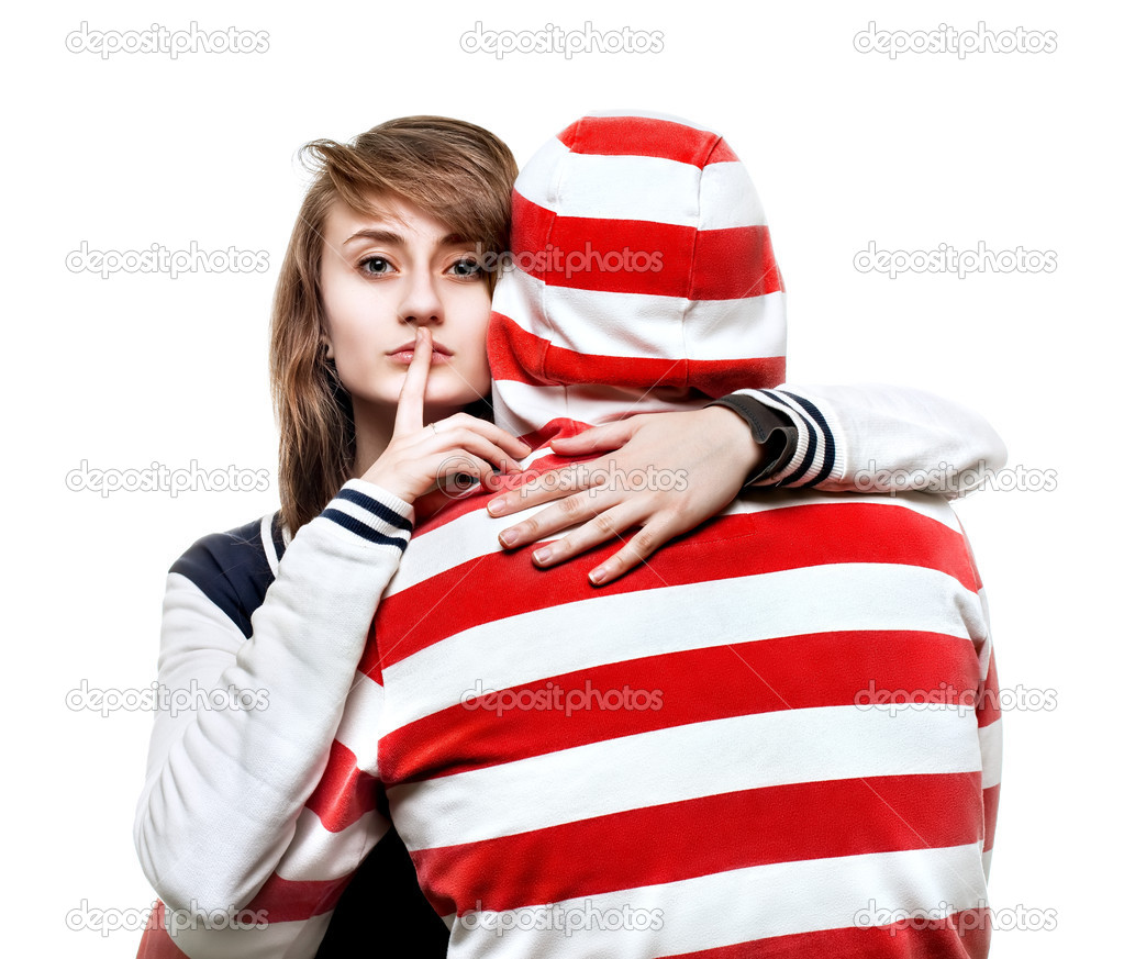 Portrait of a girl hugging a young man in the hood  Stock Photo #10257483