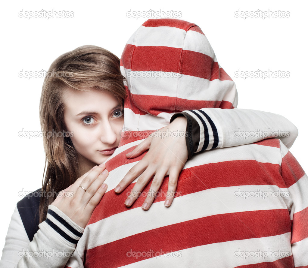 Portrait of a girl hugging a young man in the hood — Stock Photo #10264700