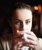 Woman enjoying coffee and dreaming — Stock Photo