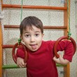 Foto de Stock  : Child at home sport gym
