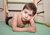 Child lies on a sport mattress — Stock Photo