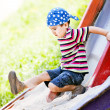 Stock Photo: Boy playing on slide