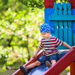 Boy playing on slide — Stock Photo