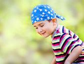 Young boy wearing bandana — Stock Photo