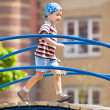 Young boy in bandana on playground — Stock Photo