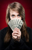 Woman holding fan of money — Stock Photo
