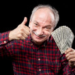 Elderly man showing fan of money — Stock Photo