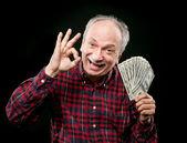 äldre man visar fan pengar — Stockfoto