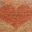 Heart on old brick wall — Stockfoto