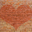 Heart on old brick wall — 图库照片