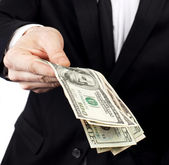 Businessman offering money — Stock Photo
