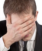 Man covering his face by hand — Stock Photo